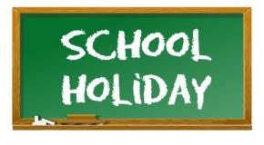 school holiday written in chalk